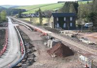 A new perspective on Fountainhall station, looking south from the approach to the new road overbridge on 26 April 2015. All trace of the Borders Railway works compound established here in early 2014 has now gone - as has the former level crossing that once took the old road past the station house. [See image 47882]<br><br>[John Furnevel&nbsp;26/04/2015]