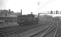 Well turned out J21 0-6-0 65033 takes the goods lines past Newcastle Central heading for the King Edward Bridge early one grey Saturday morning in May 1960. The 1889 locomotive was on its way from Heaton to Darlington where it would take charge of the SLS/SDLS <i>J21 Rail Tour</i> to Carlisle via Stainmore. [See image 36451]<br><br>[K A Gray&nbsp;07/05/1960]