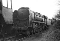 Apart from the removal of all rods, No 35005 <I>Canadian Pacific</I> was still in reasonably complete condition when photographed in Woodham's yard at Barry on March 14 1970. For company, it has Standard Class 5 4-6-0 No. 73096, one of the locos whose tender was sold by Woodham's for conversion to an ingot carrier at the Briton Ferry steel works. At the rear is an ex-GWR Castle, probably No. 5043 <I>Earl of Mount Edgcumbe</I>. [See image 18430]<br><br>[Bill Jamieson&nbsp;14/03/1970]
