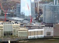 South Eastern services from the west running into London Bridge on 25 April 2015 passing The Shard. The red cranes are for the ongoing rebuilding of London Bridge Station.<br><br>[John Thorn&nbsp;25/04/2015]