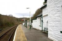 Platform view at Pont-y-Pant on 14th April 2015. The former Gents (centre) which now forms part of the accommodation of the private residence in the station building seems more generously proportioned than the present shelter for passengers - and certainly more substantial in construction. <br><br>[Colin McDonald&nbsp;14/04/2015]