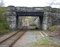 View from what was formerly the end of the island platform at Dolwyddelan on 14th April 2015. The infilled section in the parapet is where the access steps met the overbridge.<br><br>[Colin McDonald&nbsp;14/04/2015]
