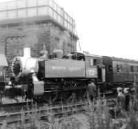 Formerly of USA Transportation, Southern Railway, and British Railways. USA Class 0-6-0T 30072, seen in one of its many guises as Worth Valley no 72, is one of the locomotives on the re-opening special awaiting departure from Keighley Station on 29 June 1968. [See image 24540]<br><br>[David Pesterfield&nbsp;29/06/1968]