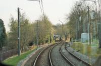 Although Woodlands Road only finally closed in December 2013 the station has been quickly cleared. This view from a Manchester bound Metrolink service in April 2015 shows the newly landscaped area where the platforms once stood. [See image 47605] for the same location the previous summer. <br><br>[Mark Bartlett&nbsp;20/04/2015]
