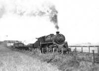 BR Standard class 4 2-6-0 76108 leaving Brucklay with an up passenger train on 16 May 1959. <br><br>[G H Robin collection by courtesy of the Mitchell Library, Glasgow&nbsp;16/05/1959]