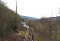 Looking southeast towards Pont-y-Pant from the approach lane overbridge in April 2015. The station had a passing loop until 1951 and also a siding along the line of the present cable duct, but only had a single platform. When the scene is observed from other viewpoints the radio mast and cabin are less obtrusive than appears here.<br><br>[Colin McDonald&nbsp;14/04/2015]