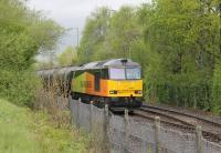 A shiny Colas Rail Class 60 waits for departure time with the bitumen empties at Strand Road sidings on 5th May 2015. The train normally runs MWF only but due to the May Bank Holiday 60021 had brought the loaded tanks from Lincolnshire on the Tuesday.<br><br>[Mark Bartlett&nbsp;05/05/2015]