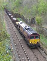 DBS 66004 passes through the closed Craiglockhart Station on the Edinburgh 'sub' on 4 May 2015 with the 6S58 Lackenby - Dalzell 'slabs'.<br><br>[Bill Roberton&nbsp;04/05/2015]