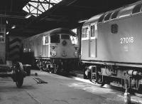 26011 and 27018 inside the main shed at Haymarket on 9 April 1983.<br><br>[Bill Roberton&nbsp;09/04/1983]