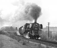 Although the border town of Gmuend in Lower Austria retained a large allocation of 2-8-2T locos until 1976, there was little in the way of standard gauge steam working in and out of the town itself (operations were centred on the sub-shed at Schwarzenau some 15 miles to the east), so that apart from a couple of workings on the narrow-gauge, the highlight of a morning spent there was the appearance of a transfer freight from Ceske Velenice on the Czech side of the border. This was normally worked by CSD No. 556 0506, a Skoda built 2-10-0 to a very advanced design, of which 510 examples were constructed between 1951 and 1958. It is seen here between the border and Gmuend station on 11th September 1975.<br><br>[Bill Jamieson&nbsp;11/09/1975]
