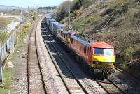 A Mossend to Daventry container service is double headed through Hest Bank by DBS 90036 and 90026 on 21st April 2015.<br><br>[Mark Bartlett&nbsp;21/04/2015]