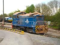 Aggregate Industries GM built Bo-Bo shunter <I>Western Yeoman II</I> runs back onto a rake of empty wagons at Merehead on 8 May 2015. Meantime another GM built loco 59005 stands at the end of a heavily loaded train ready to provide additional rear end power needed to  ensure it could ascend the gradient onto the branch from Witham Friary.<br><br>[David Pesterfield&nbsp;08/05/2015]