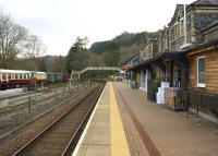 View south on the remaining single platform at Betws-y-Coed on 14th April 2015. The static coaches and vans on the right are part of the Conwy Valley Railway Museum and are located on a section of the line to the former goods shed.<br><br>[Colin McDonald&nbsp;14/04/2015]
