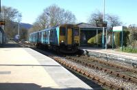 Having paused at the signalbox to exchange tokens, the 1653 Llandudno - Blaenau Ffestiniog carries on through North Llanrwst station on 14th April 2015 without being requested to stop.<br><br>[Colin McDonald&nbsp;14/04/2015]