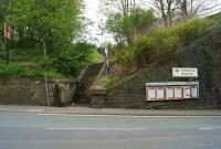 The main road is quite a way below the platforms at Kearsley with a few more than 39 steps to reach the platform. If you miss the notice that the station is closed until October then you could have a wasted journey as the rail replacement coach picks up alongside the road. It is also interesting that on 10 May 2015 the station sign still refers to 'British Rail'.<br><br>[John McIntyre&nbsp;10/05/2015]