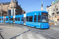 A Number 7 tram, a Flexity Swift A32, turns from Strandvagen on to Djurgardsbron in Stockholm on 16 March 2015. <br><br>[Colin Miller&nbsp;16/03/2015]