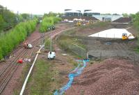A hive of activity in the area around Newcraighall South Junction on Sunday morning 10 May 2015. View is south, showing work taking place in several locations at the northern end of the Borders Railway, not least on the new bridge that will eventually carry the link from Whitehill Road into the recycling plant.<br><br>[John Furnevel&nbsp;10/05/2015]