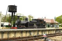Scene on the Isle of Wight Steam Railway at Haven Street on 9 May 2015. The locomotive is Adams O2 0-4-4T W24 <I>Calbourne</I>, masquerading on this occasion as W33 <I>Bembridge</I>. [See image 23635] <br><br>[Peter Todd&nbsp;09/05/2015]