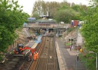 A view of Farnworth station towards the tunnels (and Salford Crescent) on 10 May 2015 as the platform on the left is being removed in order to realign the approach to the tunnel. Although the line was closed over the weekend it is open Monday to Friday with all services using the down line (on the right) while work continues on the left hand bore. The station is however closed throughout the work which is scheduled to last until October.<br><br>[John McIntyre&nbsp;10/05/2015]