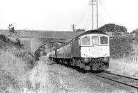 The 13:10 Waterloo to Exeter St. Davids (1V13) rolls through pleasant Devon countryside between Feniton and Whimple, where it was one of the few trains booked to stop. BRCW Type 3 No. 6540 is displaying the Southern Region route code for Waterloo - Exeter, although by the time of the photograph in 1972 the section of the former LSWR main line west of Salisbury was firmly in Western Region territory following the 1963 boundary changes. 	<br><br>[Bill Jamieson&nbsp;15/09/1972]