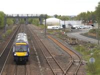 The 1100 Edinburgh - Glasgow Queen Street, formed by DMU 170431, passes  through the former Cadder yard on 13 May 2015. The new EGIP depot stands on the right. [See image 16962]<br><br>[Colin McDonald&nbsp;13/05/2015]