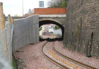 View north through Ladhope Tunnel, Galashiels, on 4 May 2015 showing the widening carried out to accomodate the Borders Railway. Part of the new pedestrian footbridge on Buckholmside is visible in the background.<br><br>[John Furnevel&nbsp;04/05/2015]