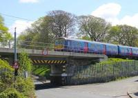 Crossing the low bridge over Torrisholme Road in Lancaster on 12th May 2015 is ex-Thameslink 319366, on yet another Northern driver training run between Preston and Carnforth. The train has just crossed the River Lune and is now approaching the junction for the Morecambe branch. <br><br>[Mark Bartlett&nbsp;12/05/2015]