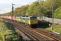 86613 and 86622, two of the 16 strong Freightliner Class 86 fleet, take the evening Coatbridge to Crewe train south at Scorton on 13th May 2015. The former E3148 and E3174 are approaching the footbridge at Broad Fall Farm. <br><br>[Mark Bartlett&nbsp;13/05/2015]