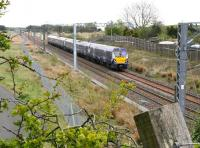 The 1048 Edinburgh Waverley - Helensburgh Central approaching Forrestfield, North Lanarkshire, on 15 May 2015.<br><br>[John Furnevel&nbsp;15/05/2015]