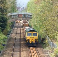 Freightliner 66509 stands on the up line between Moses Gate and Farnworth on 10 May 2015. It was one of several engineering trains operating in connection with track relaying work around Moses Gate station.<br><br>[John McIntyre&nbsp;10/05/2015]