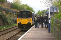 The first service to use the reinstated Todmorden Curve, the 2J61 0818 hrs Blackburn to Manchester Victoria, arrives at Burnley Manchester Road station on time on Sunday 17 May 2015. [See news item]<br><br>[John McIntyre&nbsp;17/05/2015]