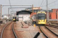 View from a city bound tram approaching Cornbrook, which opened to passengers in 1999 but was only an interchange between Altrincham and Eccles trams until 2006 when a street access point opened. The approaching tram is passing over the points for the Eccles line while to the right are the Network Rail tracks of the Irlam and Warrington line.  <br><br>[Mark Bartlett&nbsp;20/04/2015]