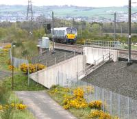 The 1023 Edinburgh - Helensburgh service approaching the Armadale stop on 15 May 2015. The town of Bathgate occupies most of the background. <br><br>[John Furnevel 15/05/2015]