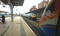 A down CrossCountry Voyager meets an up East Midlands Meridian at Derby on 4 May, while a Nottingham service approaches Etches Park in the background. <br><br>[Ken Strachan&nbsp;04/05/2015]