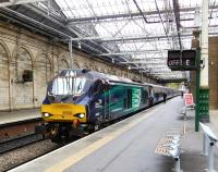 A gleaming 68002 <I>Intrepid</I> gets 'the off' with ECS from the morning Fife service, following arrival back at Waverley on 18 May 2015. It had been routed into Platform 11 on this occasion rather than the usual Platform 2.<br> <br><br>[David Panton&nbsp;18/05/2015]