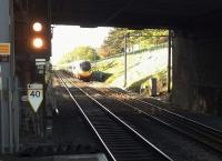 This up Pendolino is accelerating away from a stop at Birmingham International on 12 May. It has just passed the original Hampton station [see image 51339] and will now pass through Hampton-in-Arden non-stop.<br><br>[Ken Strachan&nbsp;12/05/2015]