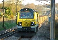 Travelling north on the Down Fast line passed Euxton Balshaw Lane station, Freightliner 70005 hauls a Network Rail ballast train on 18 April 2015.<br><br>[John McIntyre&nbsp;18/04/2015]