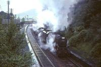 Black 5 45359 and an unidentified classmate struggle to restart a long train of empty stock from the up loop and on through Abington station on 30 July 1966 during heavy rain. [See image 51334]  <br><br>[John Robin&nbsp;30/07/1966]
