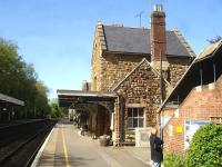 Looking west along the London bound platform at Sherborne in May 2015 showing the 1860 station building, complete with platform canopy. Part of the covered footbridge staircase stands on the right. <br><br>[David Pesterfield&nbsp;12/05/2015]