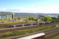 An Inverurie - Edinburgh service climbs west out of Dundee towards the Tay Bridge on 16th May 2015. The coach in the siding is a staff car off the <I>Royal Scotsman</I> with an axle problem awaiting attention.<br><br>[Colin McDonald&nbsp;16/05/2015]