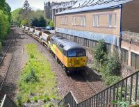 Colas 56087 with an Alloa - Millerhill empty ballast train runs through the site of Newington station on 17 May 2015.<br><br>[Bill Roberton&nbsp;17/05/2015]