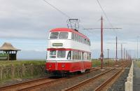 The <I>Gold</I> Blackpool Heritage timetable on 24th May meant six classic trams were in service, including <I>Balloon</I> No. 701. The red and white double decker is seen here on the cliffs approaching Little Bispham station with one of five services that worked through to Fleetwood.   <br><br>[Mark Bartlett&nbsp;24/05/2015]