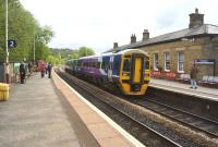 Northern 158816 on a westbound Calder Valley service calls at Todmorden on 17 May 2015.<br><br>[John McIntyre&nbsp;17/05/2015]