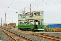 Blackpool <I>Standard</I> No. 147 accesses the turning circle at Little Bispham with a heritage tour while the conductor resets the points for the through line. Looking at this traditionally designed tramcar from the 1920s it is easy to understand the impact of the streamlined <I>Balloons</I> that were brought into service less than ten years later [See image 25693]. <br><br>[Mark Bartlett&nbsp;24/05/2015]