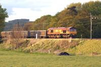 The evening sun catches DBS 66019 heading south along the WCML near to Garstang & Catterall on 13 May 2015. The train is the 6V71 Hardendale Quarry to Margam limestone working.<br><br>[John McIntyre&nbsp;13/05/2015]
