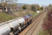 A cement empties train from Avonmouth to the Castle Cement plant at Horrocksford approaches Clitheroe station behind DBS 66023. The cement plant is less than a mile beyond here and the loco will run round at Horrocksford Junction before propelling the wagons along the short branch into the terminal. <br><br>[Mark Bartlett&nbsp;18/04/2015]