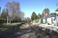 Late afternoon sunshine at Tal-y-Cafn on 14th April 2015. The board on the retained but disused up platform still displays the full former name of Tal-y-Cafn & Eglwsbach.<br><br>[Colin McDonald&nbsp;14/04/2015]
