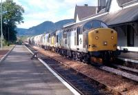 A pair of class 37s with a cement train southbound through Dunkeld in 1990.<br><br>[Ewan Crawford&nbsp;//1990]