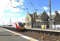 Virgin Pendolino 390115 races through Kirknewton on 26 May 2015 on the 08:43 service from London Euston to Edinburgh Waverley.<br><br>[Malcolm Chattwood&nbsp;26/05/2015]