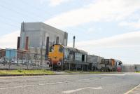 DRS EE Type 1s 20305 and 20309, just arrived at Heysham Power Station on 26th May, with two empty flasks from Sellafield. The flask wagons will be exchanged for a return load and moved into the nuclear complex by the internal shunter. <br><br>[Mark Bartlett&nbsp;26/05/2015]